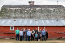 Large Family photograph in front of red barn by Collin Stumpf Photography