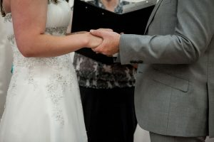 wedding ceremony holding hands detail